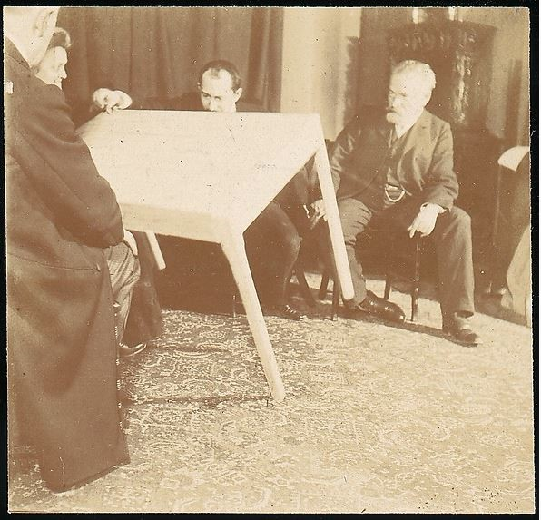 Photograph of Jules Courtier at a seance with Palladino in 1907